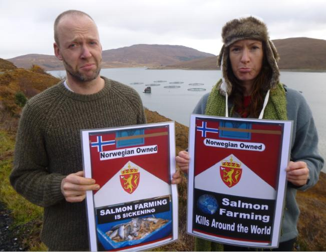Arthur Sevestre & Elena outside MH farm with sickening and global signs