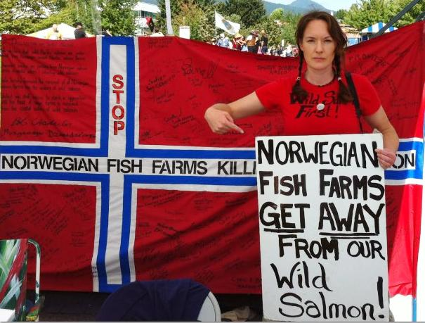 Elena with flag and sign