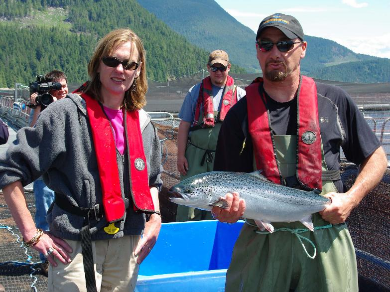 Claire Trevena Marine Harvest visit photo with salmon