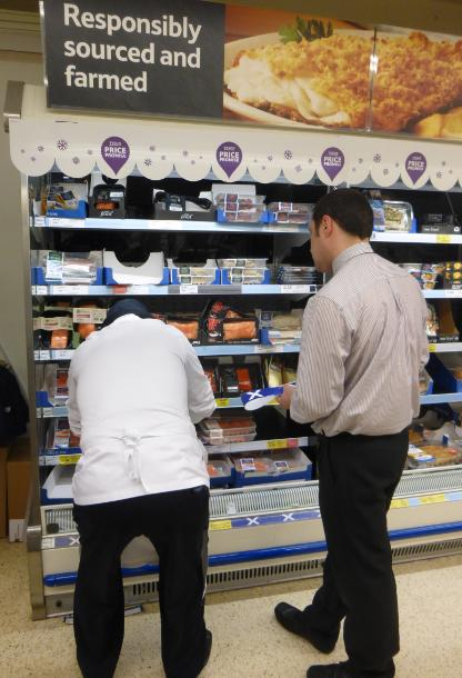 Low res photos #13 Tesco Corstorphine 29 March 2014 Manager removing Scottish flags