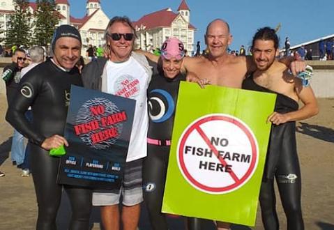 Swim against fish farm photo #1