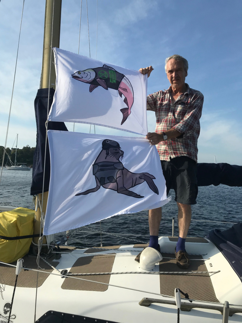 Flags on boat Salmon & Seal with Andrew holding